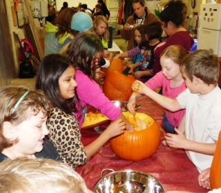 5th graders eagerly gut pumpkins and clean the seeds at Cascadian Farm October 29, 2015.jpg