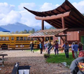6th graders carry their pumpkins to the bus at the end of the Cascadian Farm field trip on October 22, 2015.jpg