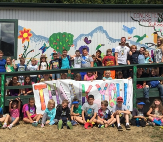 Concrete Summer Learning Adventure Campers in front of the Farm to School classroom..jpg