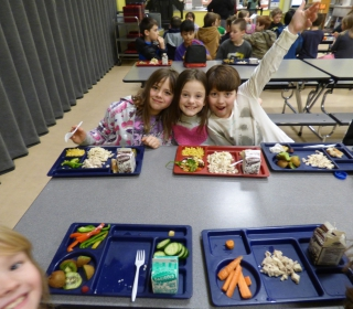 Elementary students enjoy fresh vegetables on Winter Taste Washington Day.